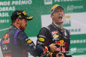 Race winner Sebastian Vettel, Red Bull Racing celebrates on the podium with team mate Mark Webber, Red Bull Racing
