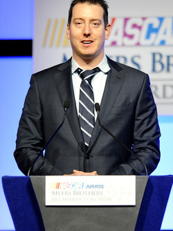 Kyle Busch speaks onstage after winning the American Ethanol Green Flag Restart Award at the NMPA Myers Brothers Awards Luncheon