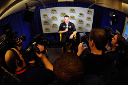 Tony Stewart speaks with the media