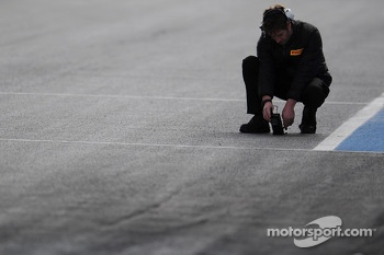 Pirelli tyre technician takes a track temperature reading