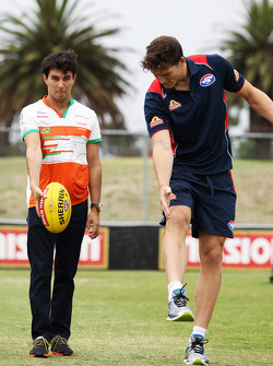 (L to R): Sergio Perez, Sahara Force India F1 practices his Aussie Rules skills with Will Minson, Western Bulldogs Australian Rules Footballer at Whitten Oval