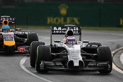 Jenson Button, McLaren MP4-29 leads Sebastian Vettel, Red Bull Racing RB10
