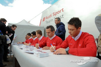 Audi drivers sign autographs