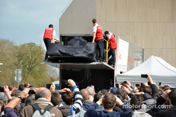 The 2014 Audi R18 e-tron quattro is unloaded on the Place des Jacobins
