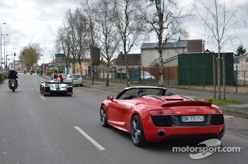 Tom Kristensen drives the Audi R18 e-tron quattro through the streets of downtown Le Mans