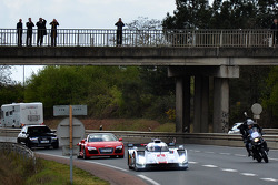 Tom Kristensen drives the Audi R18 e-tron quattro through the streets of Le Mans