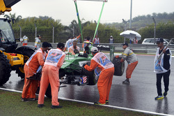 The Caterham CT05 of Marcus Ericsson, Caterham is recovered by marshalls after he crashed in qualifying