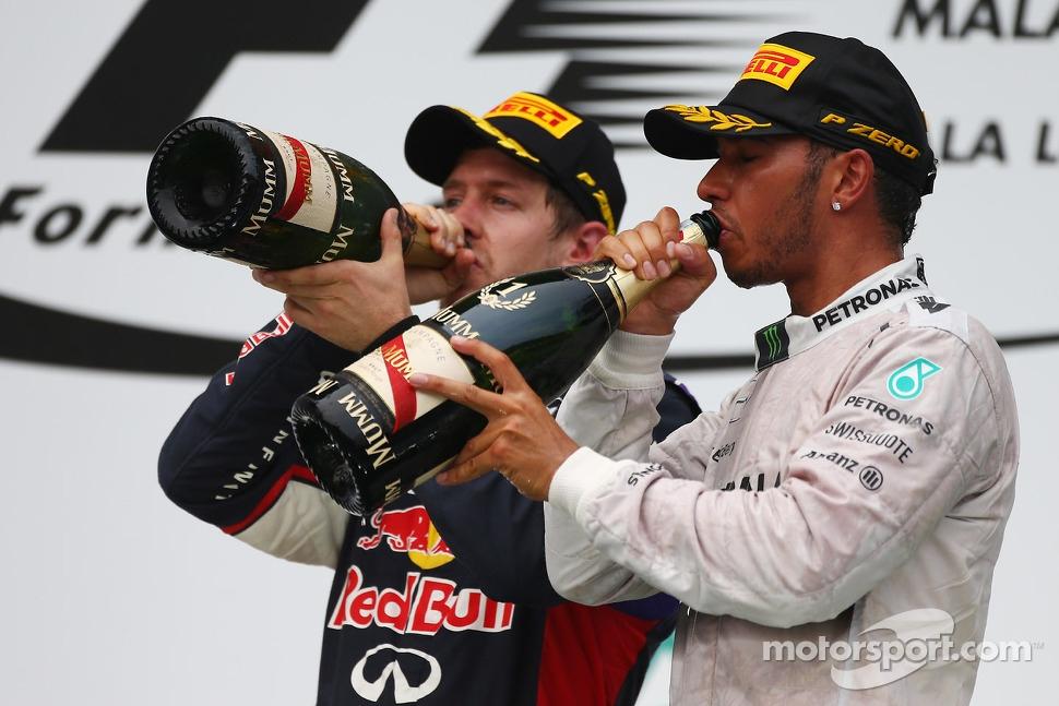 Sebastian Vettel, Red Bull Racing and Lewis Hamilton, Mercedes AMG F1