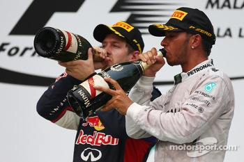 Sebastian Vettel, Red Bull Racing and Lewis Hamilton, Mercedes AMG F1