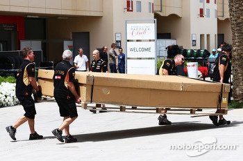 Lotus F1 Team carry freight through the paddock