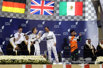 The podium, Mercedes AMG F1, second; Lewis Hamilton, Mercedes AMG F1, race winner; Sergio Perez, Sahara Force India F1, third