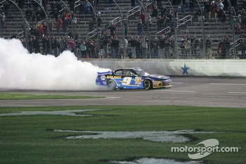 Chase Elliott does a burn out after winning the O'Reilly Auto Parts 300