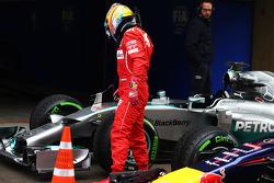 Fernando Alonso, Ferrari looks at the Mercedes AMG F1 W05 of Lewis Hamilton, Mercedes AMG F1 in parc ferme