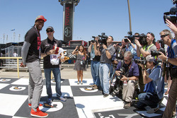 Washington Redskins quarterback Robert Griffin III offers a jersey to Matt Kenseth