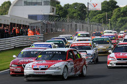 John Cleland in his 1997 BTCC Vauxhall Vectra V97-001 leads the start of race 1