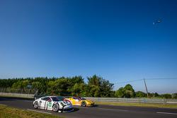 #91 Porsche Team Manthey Porsche 911 RSR (991): Patrick Pilet, Jörg Bergmeister, Nick Tandy, #66 JMW Motorsport Ferrari 458 Italia: Abdulaziz Al Faisal, Seth Neiman, Spencer Pumpelly