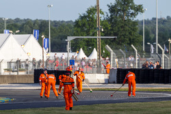 Corner workers clean during red flag
