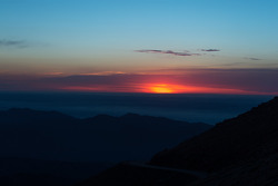 The sun rises above Pikes Peak