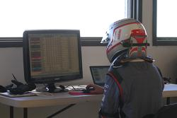 Romain Dumas checks the times on a computer at the summit