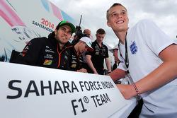 Sergio Perez, Sahara Force India F1 and team mate Nico Hulkenberg, Sahara Force India F1 sign autographs for the fans