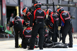 Marussia F1 Team mechanics during pitstop