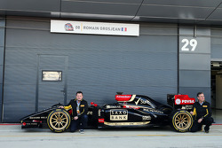 (L to R): Paul Hembery, Pirelli Motorsport Director and Mario Isola, Pirelli Racing Manager and the Lotus F1 E22 with new 18 inch Pirelli tyres and rims