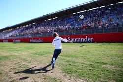 Nico Rosberg, Mercedes AMG F1 plays football on the start/finish straight