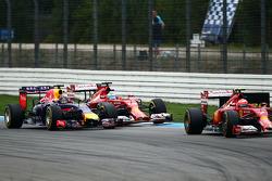 Kimi Raikkonen, Ferrari F14-T leads Fernando Alonso, Ferrari F14-T and Sebastian Vettel, Red Bull Racing RB10, who battle for position