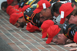 Race winner Ty Dillon kisses the yard of bricks with his team