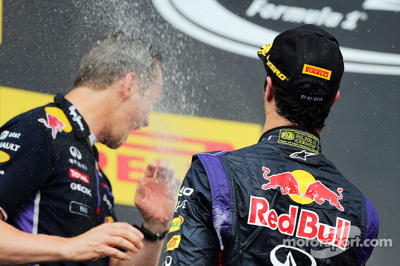 Daniel Ricciardo, Red Bull Racing celebrates with the champagne with Paul Monaghan, Red Bull Racing Chief Engineer on the podium