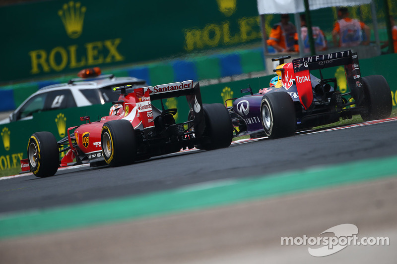 Kimi Raikkonen, Ferrari F14-T and Sebastian Vettel, Red Bull Racing