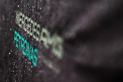 Mercedes AMG F1 logo covered in rain drops