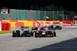 Kevin Magnussen, McLaren F1 and Sebastian Vettel, Red Bull Racing