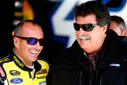 Marcos Ambrose and NASCAR president Mike Helton