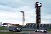 #27 Dempsey Racing Porsche 911 GT America: Patrick Dempsey, Andrew Davis and #54 CORE autosport ORECA FLM09: Jonathan Bennett, Colin Braun