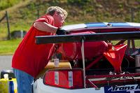 Team member fueling car