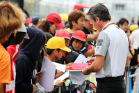 Sam Michael, McLaren Sporting Director signs autographs for the fans
