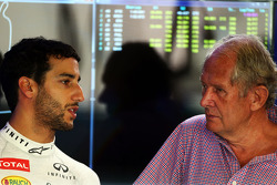 (L to R): Daniel Ricciardo, Red Bull Racing with Dr. Helmut Marko, Red Bull Motorsport Consultant