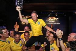 Mister Le Mans Tom Kristensen is hoisted on the shoulders of his Audi Sport teammates