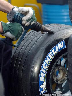 Michelin technician scrubs tires
