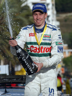 Podium: champagne for Markko Martin