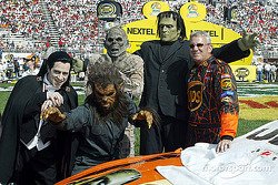Dale Jarrett poses with a few monsters