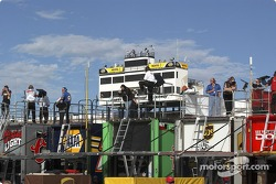 Crew members watch practice action from atop transporters