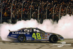 Race winner Jimmie Johnson celebrates victory with a burnout