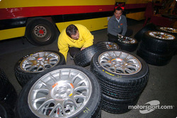 Pirelli crew members prepare the tires