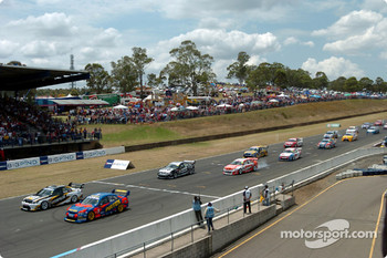 Craig Lowndes gets the jump on MarcosAmbrose at the start of Race Two