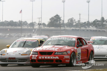 Start: #52 Rehagen Racing Mustang Cobra SVT: Mark Ackley, Audrey Zavodsky, Larry Rehagen battle with #19 Race Prep Motorsports Porsche 996: Michael Auriemma, Mike Pickett