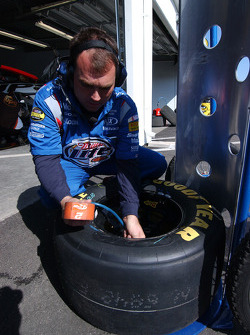 Miller Lite Dodge crew member prepares the tires