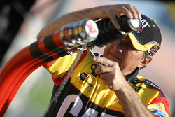 Caterpillar Dodge crew member prepares refuel equipment