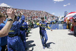 Rallly winner Petter Solberg celebrates with his team